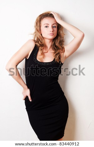 cute blond girl in a beautiful black dress