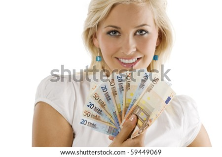 cute blond girl smiling behind a fun of euro money. FACE NOT IN FOCUS . FOCUS ON THE MONEY .