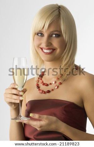 cute blond in act to toast dressing fashion color and smiling