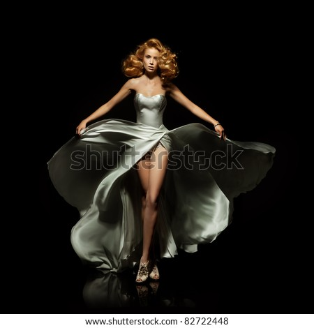 Cute blond woman in gorgeous dress - stock photo