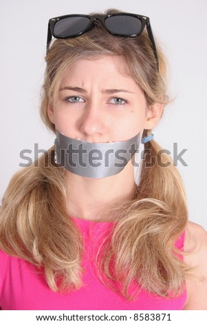 Cute blond woman with duct tape across mouth - stock photo