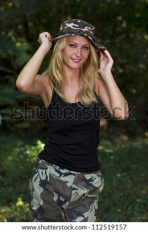 Cute blonde dressed in camouflage