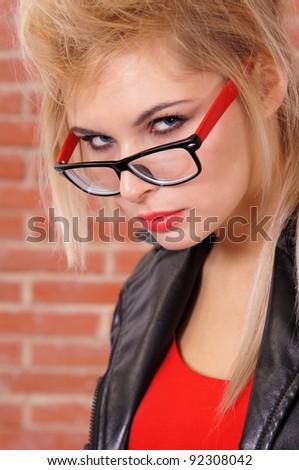 cute blonde posing  at the brick wall
