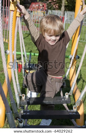 cute blonde toddler age 3 playing in a playground