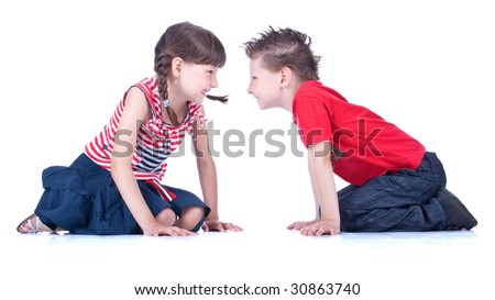 Cute blue-eyed boy and girl are playing , stidio shot