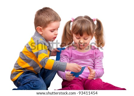 cute boy and girl are playing with a cards, isolated on white