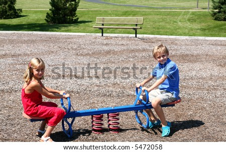 cute boy and girl playing at a park
