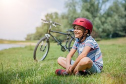 Cute boy biking. Teenager resting on a bike ride