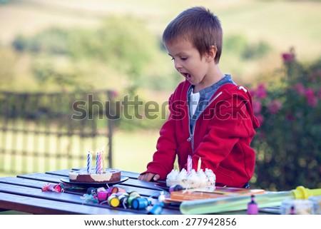 Cute boy, celebrating his birthday outdoor, summertime