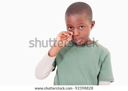 Cute boy crying against a white background - stock photo