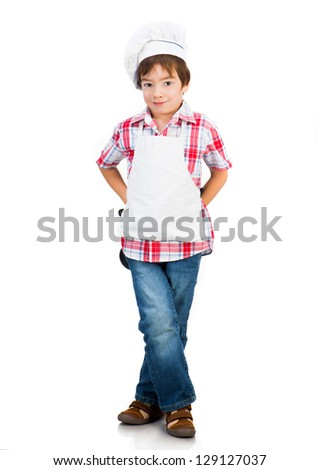 Cute boy dressed as a cook isolated on a white background