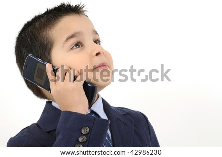 Cute boy dressed as businessman on the phone isolated on white background