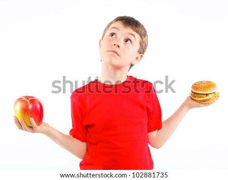 Cute boy eating a hamburger. Isolated on a white background