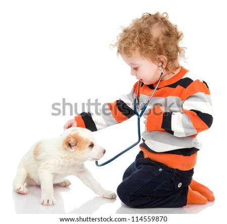 cute boy examining dog. isolated on white background