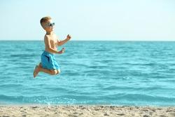 Cute boy having fun on beach