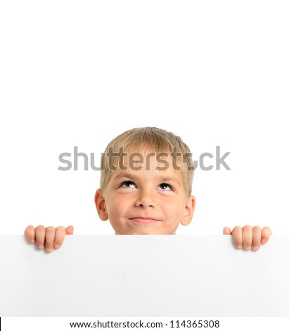 Cute boy holding white board and looking up, isolated on white