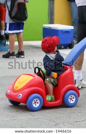 Cute boy in colorful car