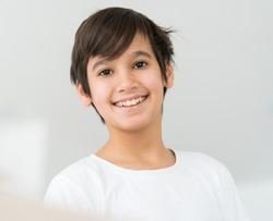 Cute boy in home closeup portrait smiling