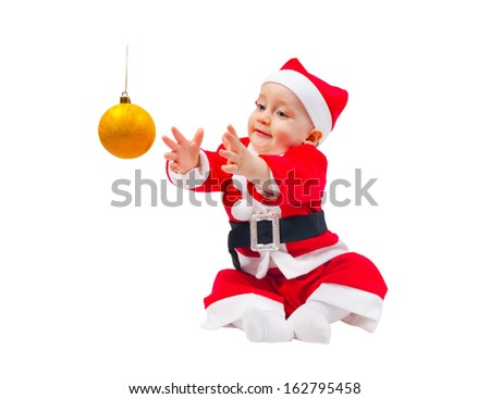 Cute boy in the costume of Santa Claus with the decoration for the Christmas tree isolated on white background