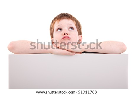 cute  boy looking up with white board,  isolated on white background. Studio shot - stock photo