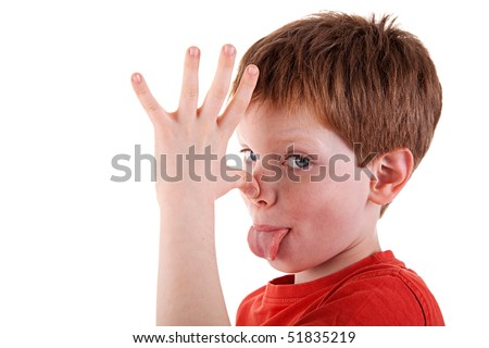 "cute boy making ""funny face"",  isolated on white background. Studio shot"