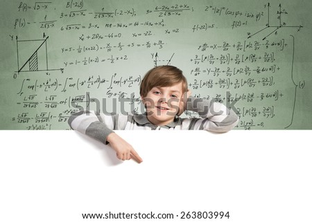 Cute boy of school age with blank advertising board