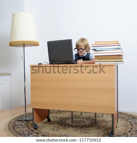 cute boy on laptop at the office desk