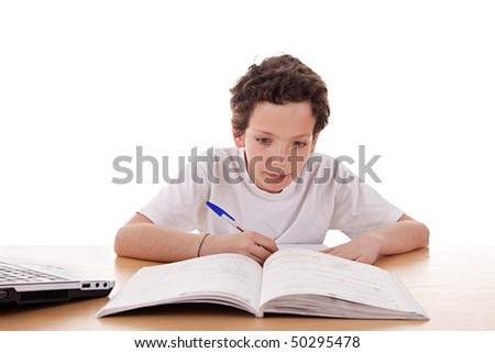 cute boy on the desk studying, isolated on white background