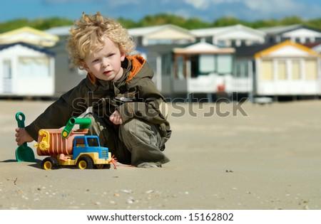 cute boy playing on the beach