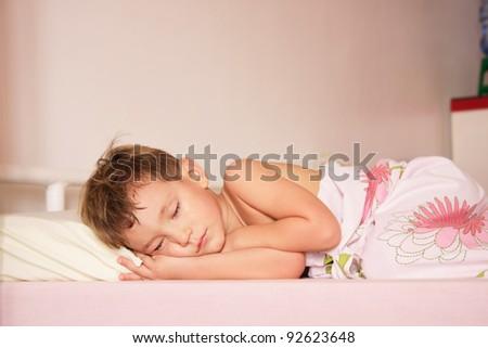 cute boy sleeping at home