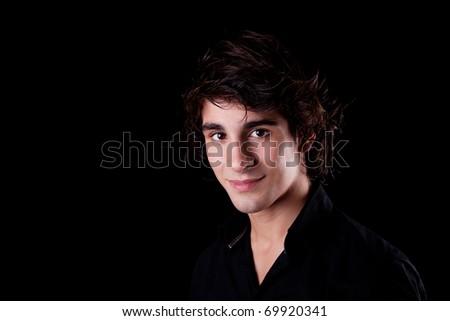 cute boy, smiling on black, studio shot