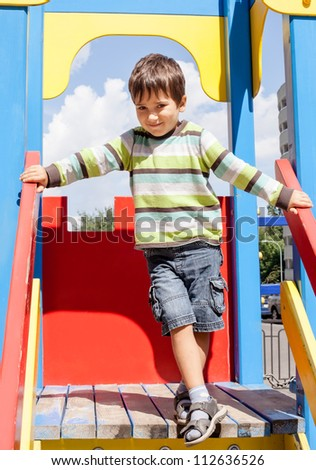 cute boy standing on playground