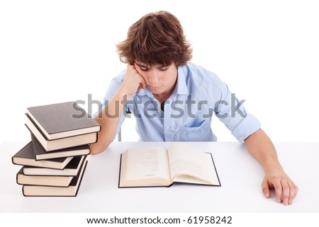 cute boy studying and reading a book on his desk, isolated on white
