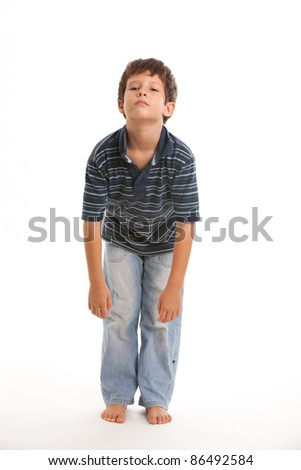 Cute boy with a bored expression on a white background.