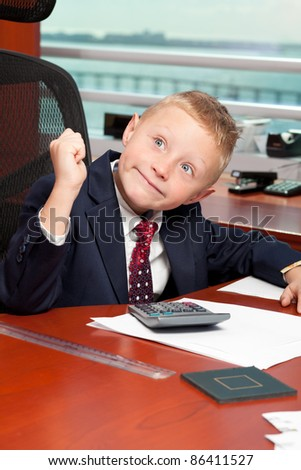 Cute boy with business attire in a corporate office.
