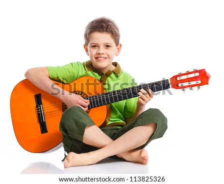 Cute boy with classical guitar Isolated on white background