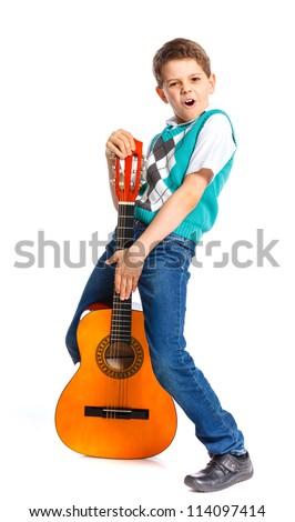 Cute boy with classical guitar. Isolated on white background