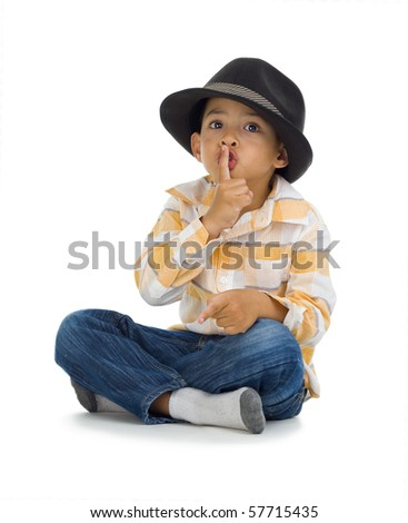 cute boy with finger on his lips, isolated on white background