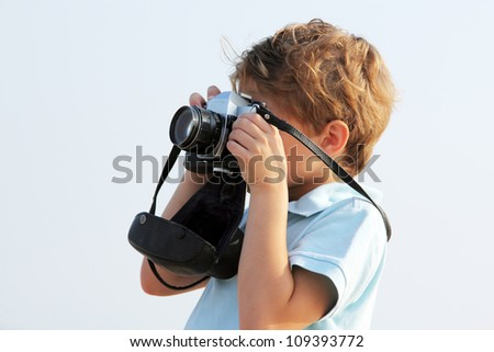 cute boy with old camera