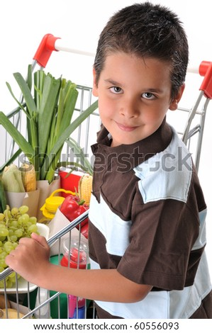 Cute boy with shopping trolley isolated on white - a series of SHOPPING TROLLEY images.