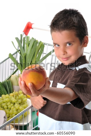 Cute boy with shopping trolley isolated on white - shallow DOF, focused on peach.