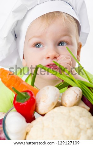 cute boy with vegetables closeup