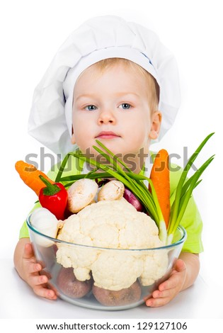 cute boy with vegetables isolated on a white