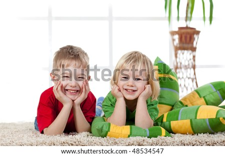 stock-photo-cute-boys-lying-on-the-floor-and-smiling-48534547.jpg
