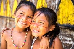 Cute Brazilian indians paying in Amazon, Brazil