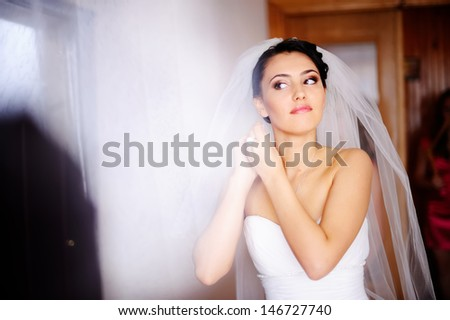 cute bride is getting ready in the morning