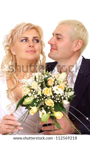 Cute bride with perfect hair in a white dress with her groom - stock photo