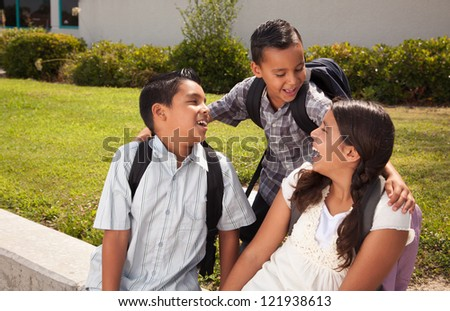 Cute Brothers and Sister Talking, Wearing Backpacks Ready for School.