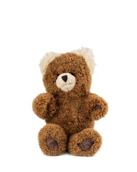 Cute brown teddy bear sitting and looking straight ahead, isolated on a white background.