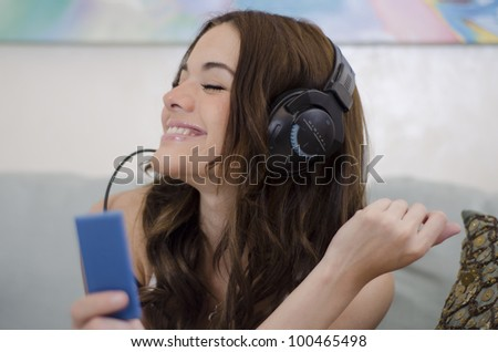 Cute brunette enjoying the moment with some nice music